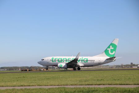 Aircraft ready for take-off at the polder runway strip at Amsterdam Airport Schiphol in the Netherlands type PH-XRX Transavia Boeing 737-7K2 Редакционное