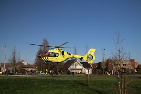 Paramedic helicopter landed on small grass field for medical emergency incident in Zevenhuizen Editöryel