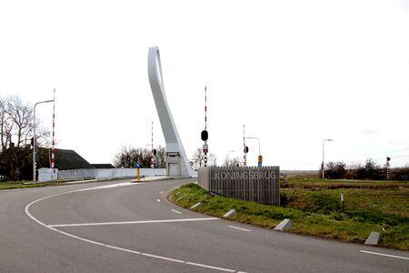 Steel bridge named Koningsbrug in Zevenhuizen over ringvaart Zuidplaspolder Canal in the Netherlands