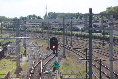 Red signals, tracks and switches on a railway yard in Rotterdam in the Netherlands Redactioneel