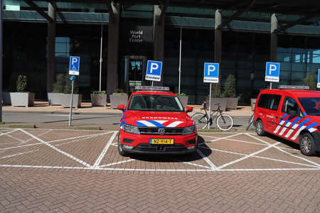 Fire brigade vehicles of staff officers parked before head office of the Security area Rotterdam Rijnmond Stockfoto