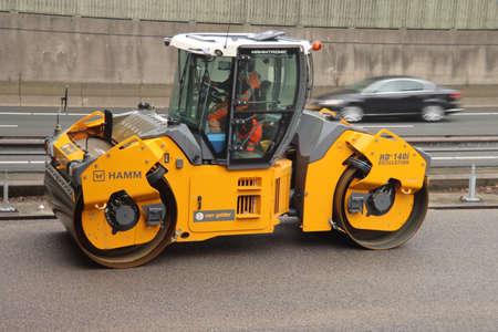 roller to flatten the asphalt during the reconstruction of the A20 motorway at Nieuwerkerk aan den IJssel