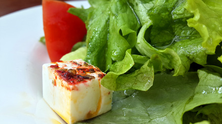 Salad with feta and spices Stock Photo