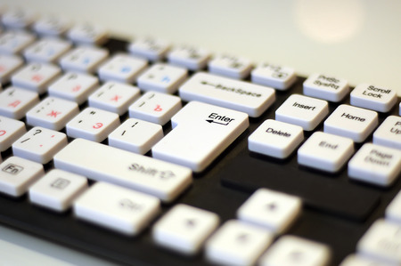 Black keyboard with white buttons keys