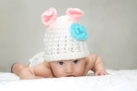 Baby boy in a rabbit hat