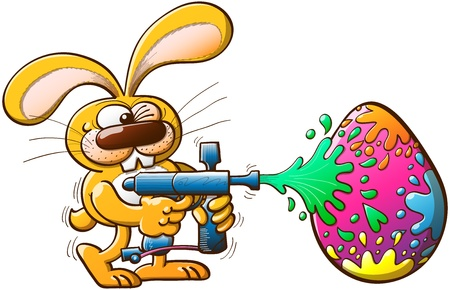 Nice bunny having fun while winking and painting a huge Easter egg with a modern paintball gun