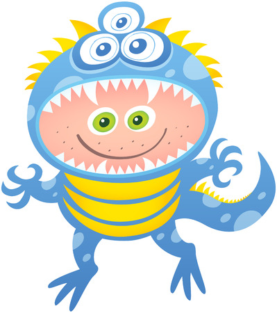 Cool boy smiling and posing while wearing a monster costume. This costume has three eyes, blue skin, sharp fangs, long tail and yellow spots. The open mouth leaves space for the boy's face