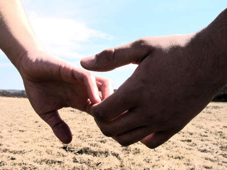 Hands parting, each going there own way.  Stock Photo
