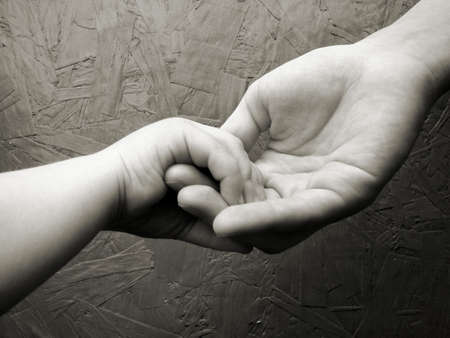 Little hand holding a big hand.