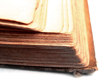 illiteracy: Close up of the edge of an open book.