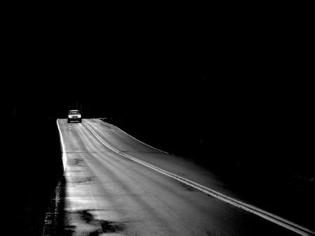 Car driving after dark on a lonely road. Stock Photo