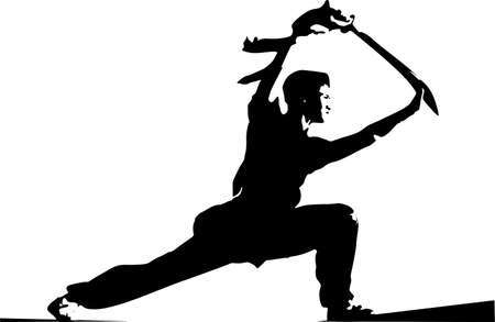 Young man doing karate with a weapon.