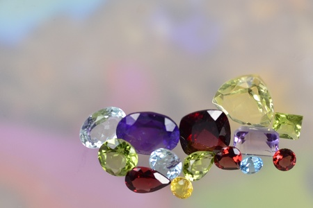 Lots of colorful gems on a pastel background photo