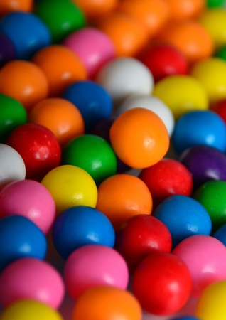 Gumballs of many colors in a group vertical