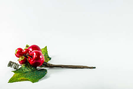 Christmas holly with red berries and green leaves horizontal at the bottom left corner over a white background. Copy space for text. Фото со стока