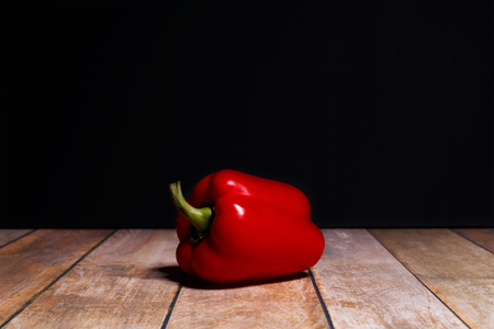 red juicy paprika on a black background Stock Photo