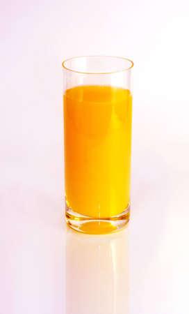 Glass of orange juice on white background Stock Photo