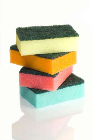 Colorful sponges on white background