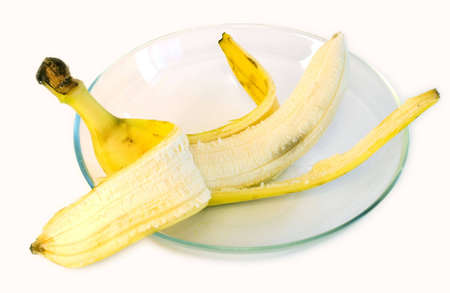Banana on glass plate on white background