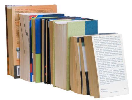 A pile of books of different colors and size