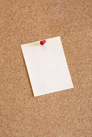 A close-up of a note page attached to the board with red pin Stock Photo