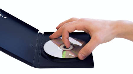 Male hand taking DVD disc from box isolated Stock Photo