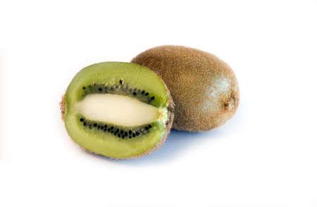 Kiwi fruit spliced and whole on white background isolated Stock Photo