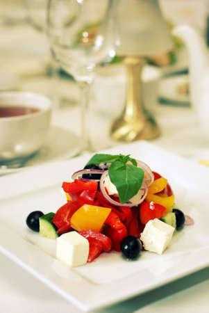 Healthy green salad on white plate in luxury restaurabt