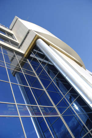 High modern building with mirror glasses and sky reflections