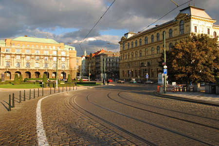 Prague street of bricks with tram lines going to brudge