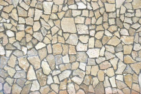 Wall of small stone fragments as a texture photo