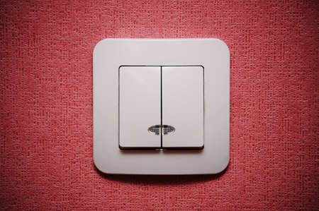 Double light switch against red wall closeup Stock Photo - 4455137