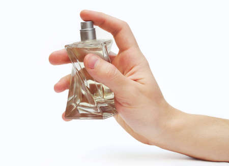 Mans hand with bottle of perfume isolated on white background Stock Photo
