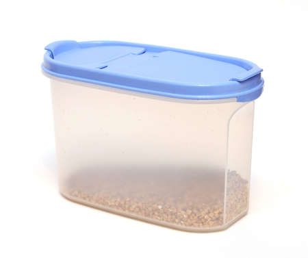 Transparent plastic food container with grain isolated on white background photo