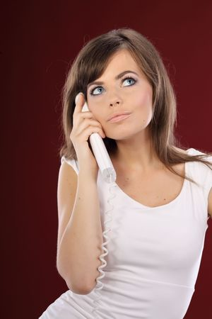 Woman on Phone . red background Stock Photo - 5138518