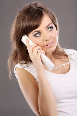 Woman on retro telephone Stock Photo - 5138512