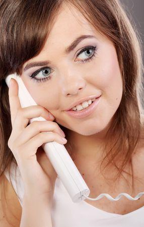 Woman on retro telephone Stock Photo - 5138520