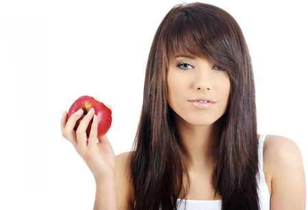 Beautiful young woman eating red apple. Isolated over white Stock Photo - 5175405