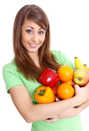 Portrait of a girl holding in hands full of different fruits and vegetables Stock Photo - 5184639