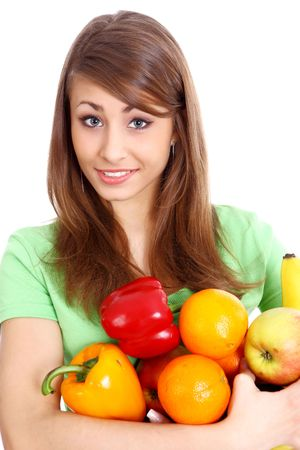 Portrait of a girl holding in hands full of different fruits and vegetables Stock Photo - 5184659