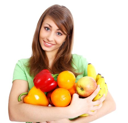 Portrait of a girl holding in hands full of different fruits and vegetables Stock Photo - 5184655