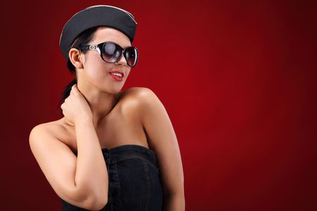 Sexy stewardess. Red background. fly and fun concept photo