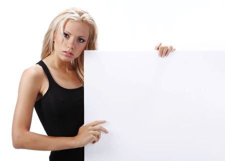 sexy girl holding a billboard add isolated over a white background Stock Photo - 5299753