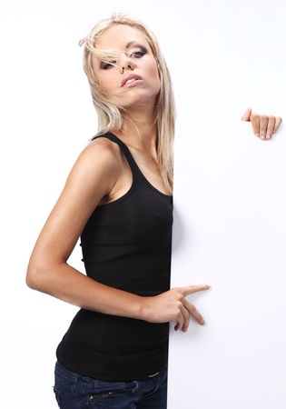 sexy girl holding a billboard add isolated over a white background Stock Photo - 5299755