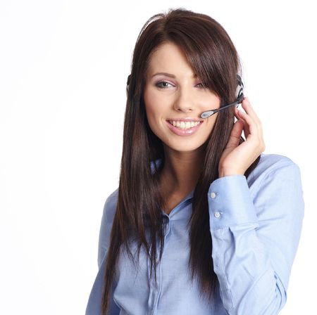 Beautiful Customer Representative with headset smiling during a telephone conversation photo