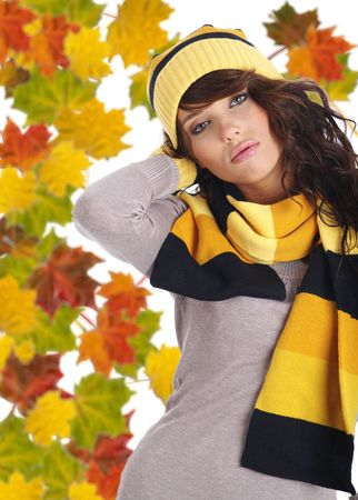 Beautiful  woman wearing hat and gloves  and maple leaves photo