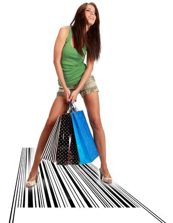 Shopping woman witn bag standing on bar code photo