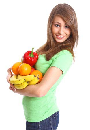 potherbs: Joven mujer sonriendo con frutas y verduras. Sobre fondo blanco Foto de archivo