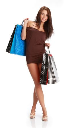 consumerism: Sexy young woman with colorful shopping bags. consumerism concept