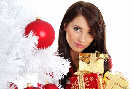 smiling girl with christmas surprise next to white tree Stock Photo - 5613003